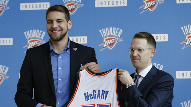 Mitch McGary is all smiles as Thunder GM Sam Presti introduces the rookie. (AP Photo)