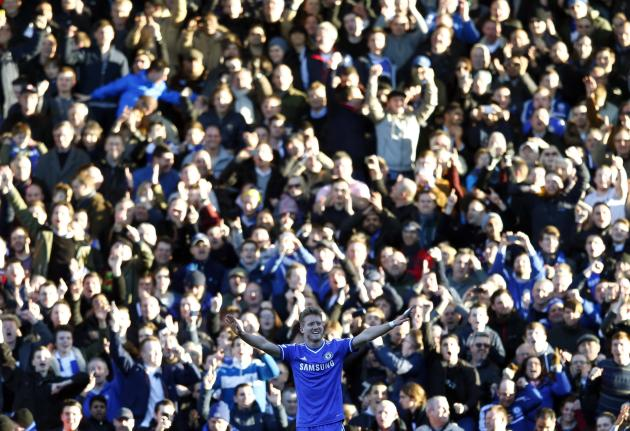 Chelsea's Andre Schurrle celebrates after scoring a hat trick against Fulham during their English Premier League soccer match in London
