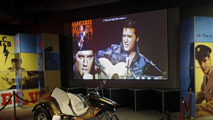 In this Nov. 25, 2013 photo, a custom motorcycle is displayed in the Elvis exhibit at the Rock and Roll Hall of Fame and Museum in Cleveland. Over 40 new items on loan from Graceland, excluding the cycle, will be displayed when the exhibit reopens. (AP Photo/Mark Duncan)