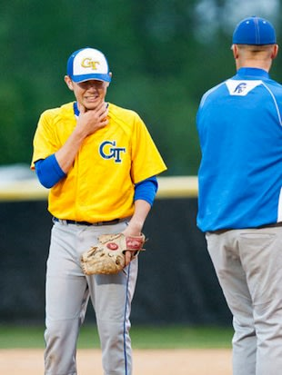 Scotty McCreery reacts after getting hit in the throat with a baseball &#x002014; News &amp;#38; Observer