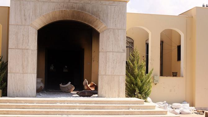Broken pots and rubble lie at the burned-out entrance to the U.S. consulate in Benghazi, Libya, Wednesday, Sept. 12, 2012, following an attack the night before by protesters angry over a film that ridiculed Islam's Prophet Muhammad. The U.S. ambassador to Libya and three other Americans were killed in the attack. (AP Photo/Ibrahim Alaguri)