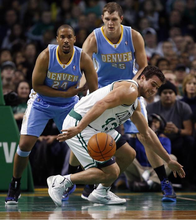 Boston Celtics' Kris Humphries (43) loses control of the ball in front of Denver Nuggets' Andre Miller (24) and Timofey Mozgov (25) in the second quarter of an NBA basketball game in Boston, F