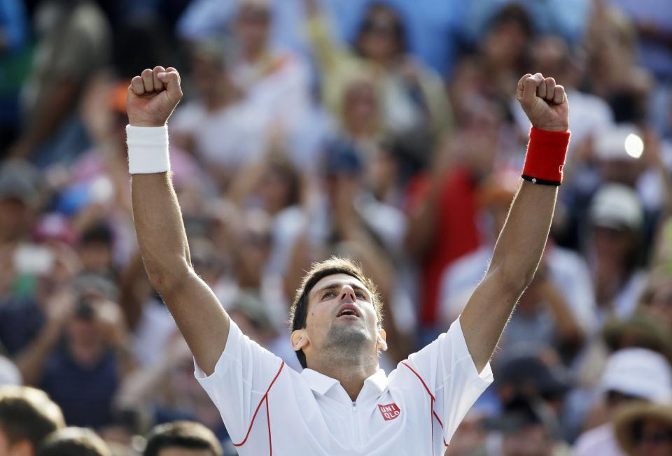 Novak Djokovic, of Serbia, reacts after beating Stanislas Wawrinka, of Switzerland, during the semifinals of the 2013 U.S. Open tennis tournament, Saturday, Sept. 7, 2013, in New York. (AP Photo/David Goldman)