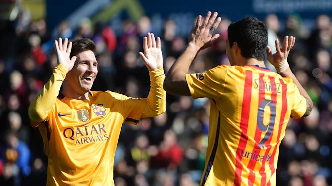 Barcelona's forward Luis Suarez (R) celebrates a goal with teammate Lionel Messi during a Spanish league football match against Levante in Valencia on February 7, 2016