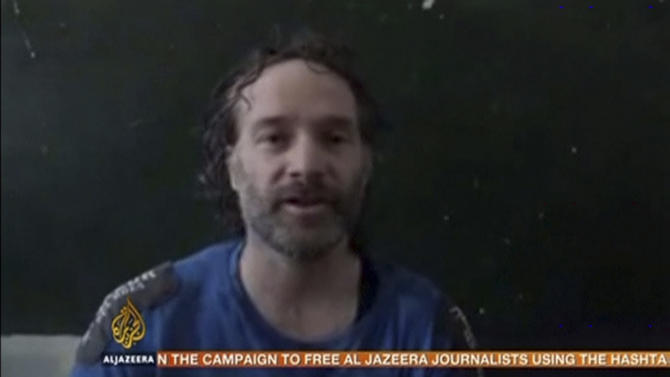 Still frame taken from video shows U.S. journalist Peter Theo Curtis, who has been freed by kidnappers in Syria