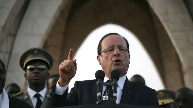 French President Francois Hollande speaks at Independence Place in central Bamako, Mali Saturday, Feb. 2, 2013. The French president was greeted by thousands of cheering supporters as he visited the embattled city of Timbuktu earlier Saturday, making a triumphant stop six days after French forces parachuted in to liberate the fabled city from the radical Islamists occupying it.(AP Photo/Thomas Martinez)