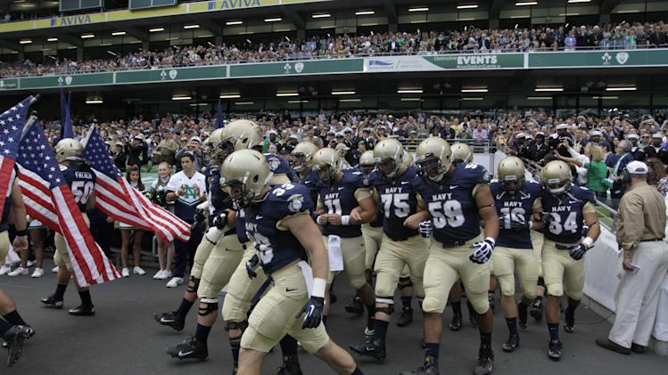 Navy football players make their way onto the pitch before their NCAA college football game against Notre Dame in Dublin, Ireland, Saturday, Sept. 1, 2012.  (AP Photo/Peter Morrison)