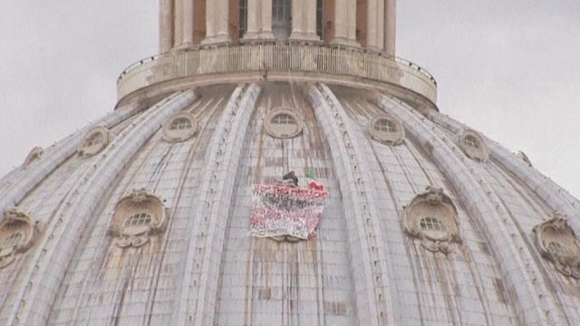 Man scales holy St Peter's for protest