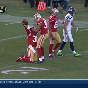 San Francisco 49ers cornerback Eric Wright picks off Russell Wilson