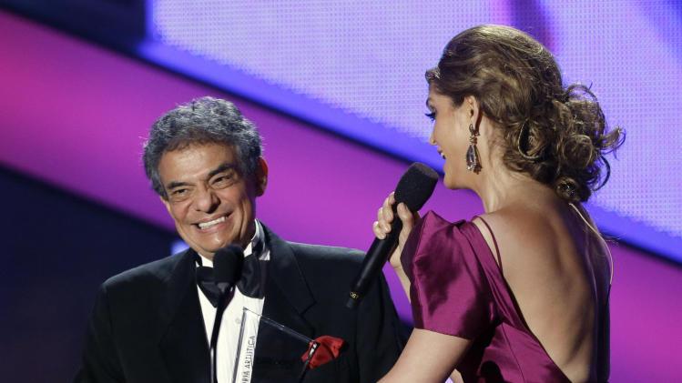 Host Ana Barbara serenades singer Jose Jose at the Latin Billboard Awards in Coral Gables, Fla., Thursday April 25, 2013. Jose Jose was presented with the Billboard Lifetime Achievement Award. (AP Photo/Alan Diaz)