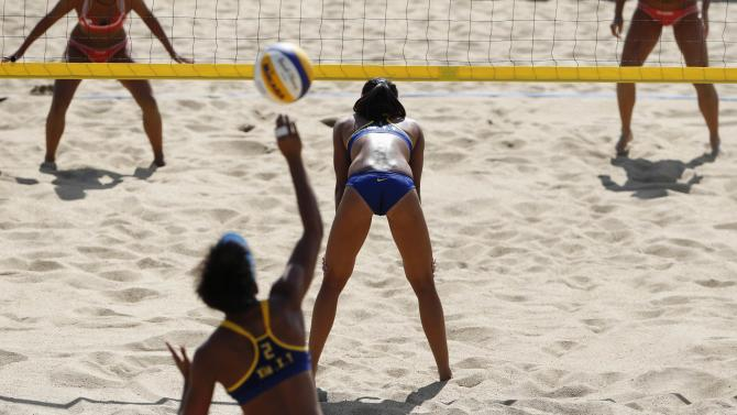 China's Xia Xinyi serves the ball against Japan during their women's preliminary beach volleyball match at Songdo Global University during the 17th Asian Games in Incheon
