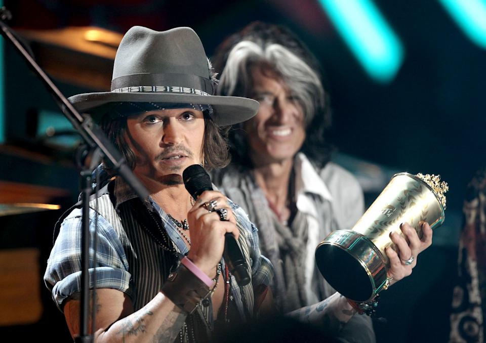 Johnny Depp accepts the the MTV Generation Award at the MTV Movie Awards on Sunday, June 3, 2012 in Los Angeles. (Photo by Matt Sayles/Invision/AP)