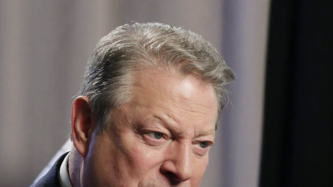 """Former U.S. Vice President Al Gore talks during an interview, Tuesday, Jan. 29, 2013 in New York. Gore, who takes aim in his new book at the corporate media for """"suffocating the free flow of ideas,"""" on Tuesday defended the sale of his own television channel to Al-Jazeera. (AP Photo/Mark Lennihan)"""