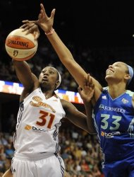 Connecticut Sun's Tina Charles (31) grabs a defensive rebound against New York Liberty's Plenette Pierson (33) during the first half of a WNBA basketball game in Uncasville, Conn., Saturday, Aug. 18, 2012.  (AP Photo/Jessica Hill)
