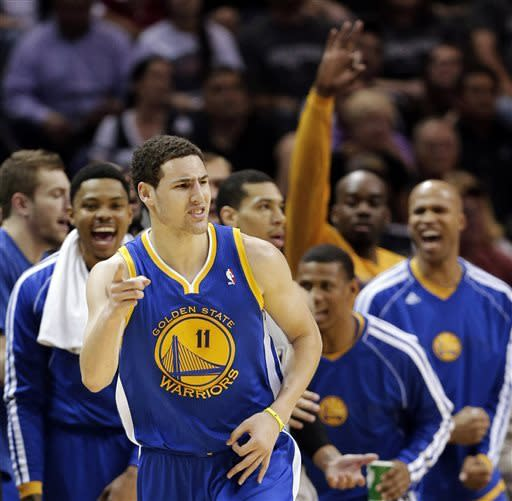 Warriors end skid at 30 in San Antonio, tie series