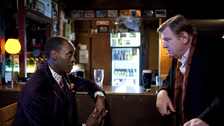 "In this film publicity image released by Sony Pictures Classics, Don Cheadle, left, and Brendan Gleeson is shown in a scene from ""The Guard."" (AP Photo/Sony Pictures Classics)"