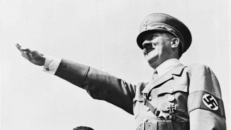 FILE-In this July 31, 1938, file photo, German Chancellor Adolf Hitler salutes a huge crowd at a sports meeting in Breslau, Germany. Causes across the political spectrum have long used distinctive salutes to identify themselves. When Anders Behring Breivik, the far-right suspect in the massacre of 77 people in Norway, pulled his right hand to his chest and then thrust his arm out with a clenched fist after an Oslo courtroom guard removed his handcuffs on Monday, April 16, 2012; it was hardly the first time such a salute has been flashed. (AP Photo/File)