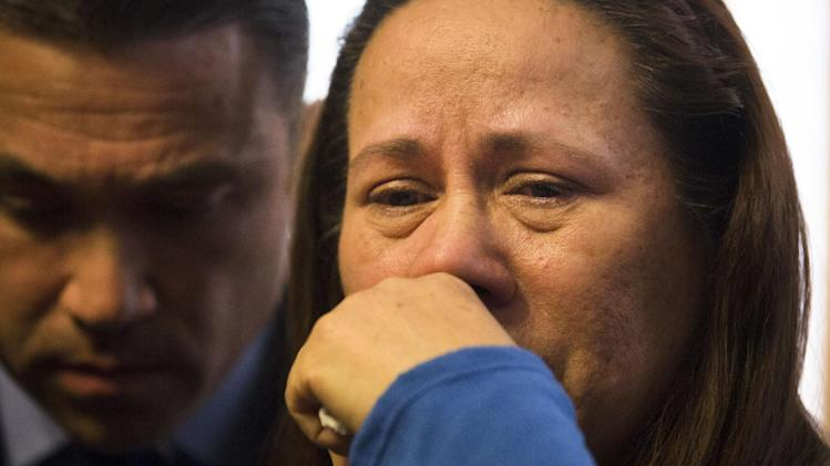 Betzaida Jimenez, mother of 33-year-old Sarai Sierra who was found dead on Saturday in Turkey, pauses during a news conference at a friend's home in Staten Island, Monday, Feb. 4, 2013, in New York. Sierra went missing while vacationing alone in Istanbul on Jan. 21, the day she was due to board her flight back home.   Congressman Michael Grimm is at left. (AP Photo/John Minchillo)