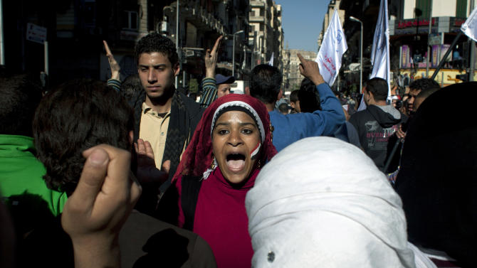 """Egyptian protesters chant slogans denouncing the proposed constitution and the upcoming referendum during a rally in Cairo, Egypt, Thursday, Dec. 13, 2012. Egyptian President Mohammed Morsi's Muslim Brotherhood and other Islamists have been plastering posters across much of the country urging Egyptians to vote """"yes"""" and listing what they call the advantages of the new charter. """"Yes, to protecting (Islamic) Sharia (laws),"""" says a Brotherhood website. The Islamists have also been using mosques to disseminate the """"yes"""" message and putting to use their appeal to uneducated Egyptians in rural areas. But the pros and cons of the draft constitution and the question of whether it will be passed have grown more akin to being a secondary narrative to the worst crisis to hit Egypt since the overthrow nearly two years ago of Hosni Mubarak's authoritarian regime.(AP Photo/Nasser Nasser)"""