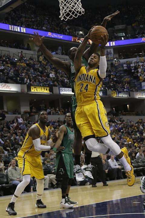 Indiana Pacers forward Paul George (24) in action during the second half of an NBA basketball game against the Boston Celtics in Indianapolis, Tuesday, March 11, 2014. The Pacers won 94-83. (AP Photo/