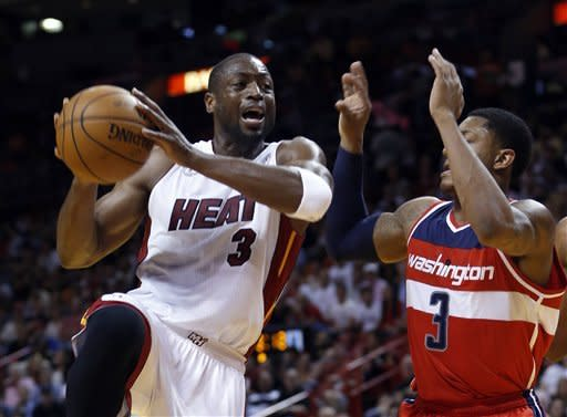 James leads Heat past woeful Wizards 99-71