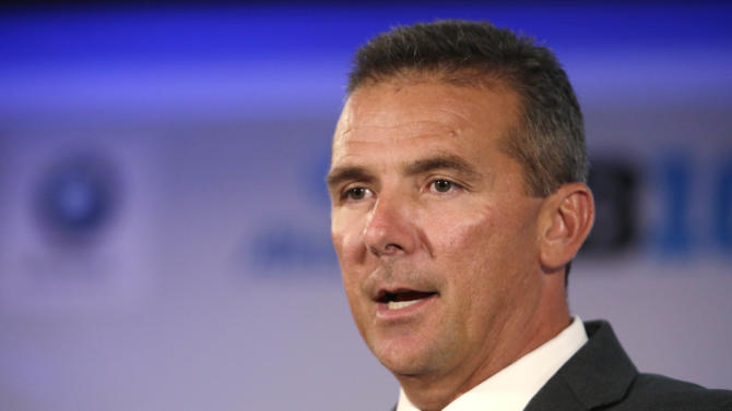 Ohio State head football coach Urban Meyer speaks during a news conference at the Big Ten conference football media day Wednesday, July 24, 2013, in Chicago. (AP Photo/M. Spencer Green)