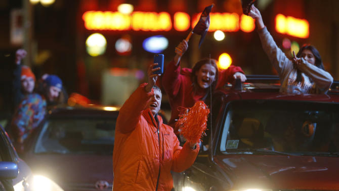 Denver Broncos fans celebrate the team's victory over the Carolina Panthers in Super Bowl 50 late Sunday, Feb. 7, 2016, in Denver. (AP Photo/David Zalubowski)