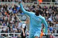 Manchester City&#39;s Yaya Toure celebrates after scoring a goal during the match against Newcastle on May 6. City are determined to usher in a new era for English football on Sunday by clinching their first title for 44 years as the curtain comes down on a thrilling Premier League campaign