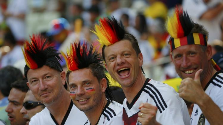 Germany fans wait for the start of their 2014 World Cup Group G soccer match against Ghana at the Castelao arena in Fortaleza