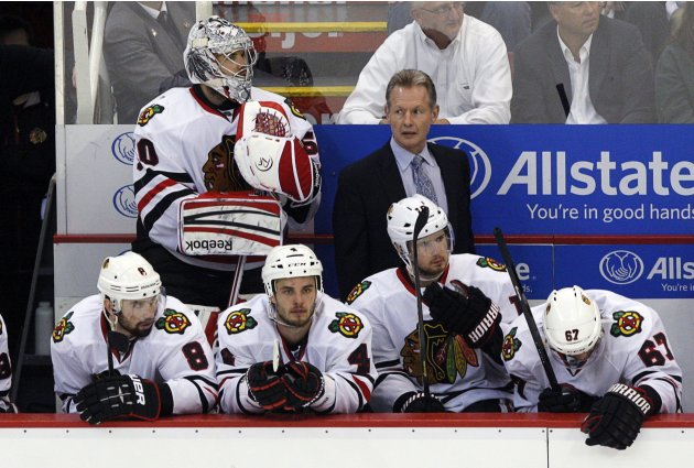 Chicago Blackhawks goalie Corey Crawford stands at the bench after being pulled for an extra attacker in the 3rd period of Game 3 of their NHL Western Conference semi-finals hockey game against the De
