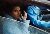 Yekaterina Samutsevich looks on as she sits in a car shortly after her release. A Russian appeals court has ordered the release of one member of anti-Kremlin punk band Pussy Riot but upheld the two-year prison sentences against the two other members