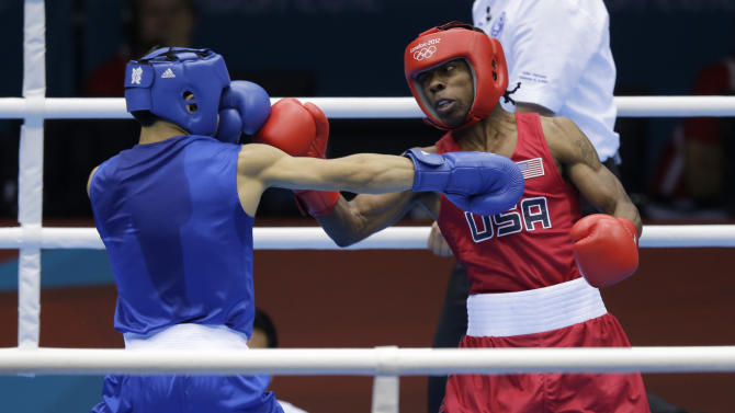 United States' Warren Raushee, right, fights France's Nordine Oubaali during a men's flyweight 52-kg preliminary boxing match at the 2012 Summer Olympics, Friday, Aug. 3, 2012, in London. (AP Photo/Ng Han Guan)