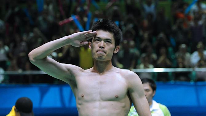 China's Lin Dan celebrates after beating Malaysia's Lee Chong Wei during their Asian Games badminton final in Guangzhou on November 21, 2010
