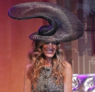 Sarah Jessica Parker in a Philip Treacy creation paired with a Chanel tweed dress
