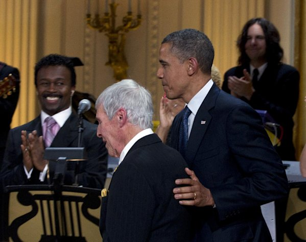 "President Barack Obama walks on stage with songwriter Burt Bacharach to present him with the 2012 Library of Congress Gershwin Prize for Popular Song during the ""In Performance at the White House"" in the East Room of the White House, Wednesday, May 9, 2012, in Washington. (AP Photo/Carolyn Kaster)"