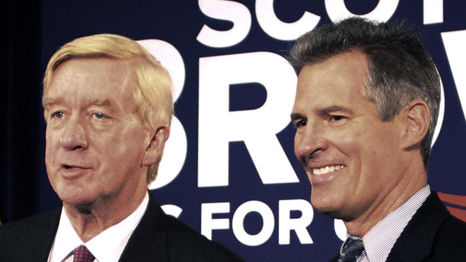 FILE - In this Oct. 5, 2012 file photo, then-Sen. Scott Brown, R-Mass., right, laughs as former Massachusetts Gov. William Weld talks with reporters after Weld endorsed Brown in Boston. Weld said Monday, Feb. 4, 2013, he will not seek the Senate seat vacated when John Kerry was named secretary of state. Brown said Friday, Feb. 1, 2013, the he would not seek that seat either.  (AP Photo/Winslow Townson, File)