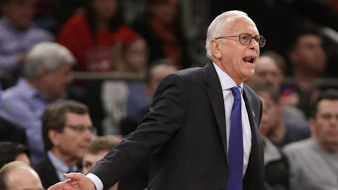 SMU coach Larry Brown calls out to his team during the first half of an NCAA college basketball game against Minnesota in the final of the NIT on Thursday, April 3, 2014, in New York