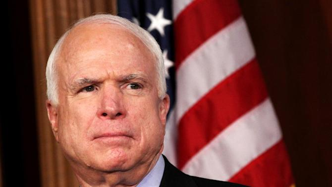 """FILE - In this March 28, 2012 file photo, Sen. John McCain, R-Ariz. listens during a news conference on Capitol Hill in Washington. McCain said in an interview posted online Friday that """"foreign money"""" was helping fellow Republican Mitt Romney's presidential hopes and singled out one of his ally's most generous supporters.  (AP Photo/Jacquelyn Martin, File)"""