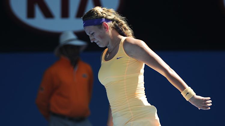 Victoria Azarenka of Belarus reacts during her semifinal match against Sloane Stephens of the US at the Australian Open tennis championship in Melbourne, Australia, Thursday, Jan. 24, 2013. (AP Photo/Andrew Brownbill)