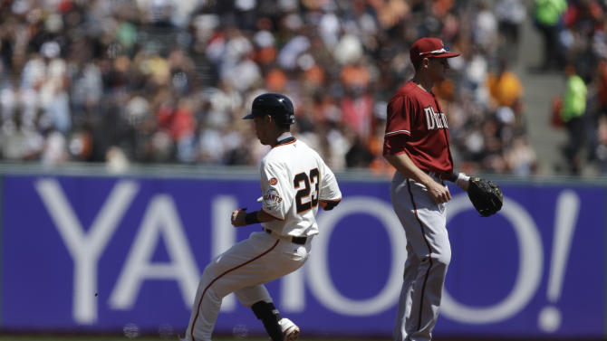 San Francisco Giants' Nori Aoki, of Japan (23) runs to decond base after hitting a double off Arizona Diamondbacks' Jeremy Hellickson in the first inning of a baseball game Sunday, April 19, 2015, in San Francisco. (AP Photo/Ben Margot)