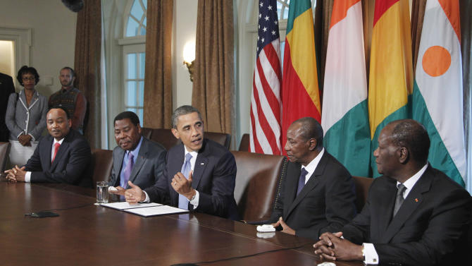 President Barack Obama meets with, from left; Niger President Mahamadou Issoufou, Benin President Boni Yayi, Guinea President Alpha Conde, and Cote d'Ivoire President Alassane Ouattara, Friday, July 29, 2011, in the Cabinet Room of the White House in Washington.  (AP Photo/Manuel Balce Ceneta)