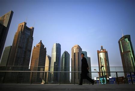 A man walks at the financial district of Pudong in Shanghai