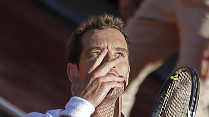 France's Richard Gasquet looks up to the sky in the last minute just before winning his third round match of the French Open tennis tournament in four sets 4-6, 7-6, 7-5, 6-4, against South Africa's Kevin Anderson at the Roland Garros stadium, in Paris, France, Saturday, May 30, 2015. (AP Photo/Francois Mori)