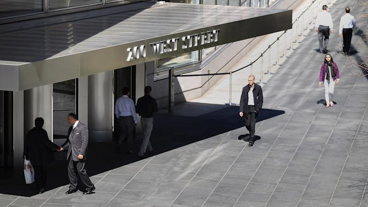 People walk past Goldman Sachs headquarters on March 14, 2012 in New York City