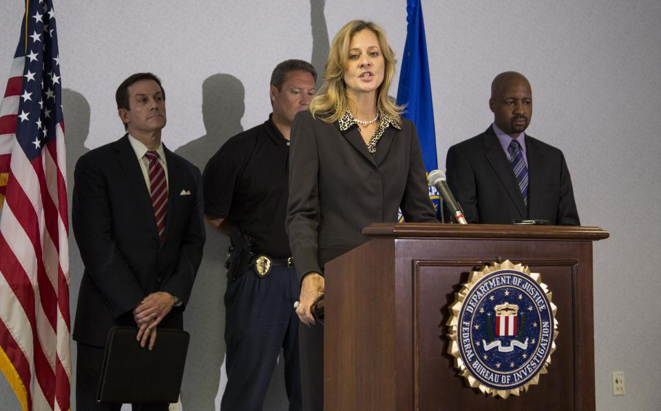 "Teresa L. Carlson, FBI special agent in charge in Milwaukee, speaks at a press briefing about the mass shooting at the Sikh Temple of Wisconsin, Wednesday, Aug. 8, 2012 in Milwaukee. ""We have not identified anyone else responsible for the shooting and we have not identified a motive,"" Carlson told the news conference. (AP Photo/Tom Lynn)"