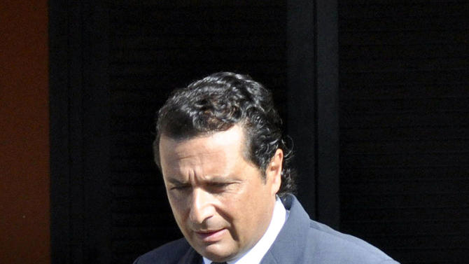 FILE -- In this file photo taken in Grosseto on May 14 2013ormer captain of the Costa Concordia luxury cruise ship Francesco Schettino leaves his house to attend a closed-door hearing. The Italian captain of the Costa Concordia cruise ship was ordered on Wednesday to stand trial for manslaughter in the luxury liner's shipwreck off the coast of Tuscany, which killed 32 people. Judge Pietro Molino, at a closed door hearing in the town of Grosseto, agreed to prosecutors' requests that Francesco Schettino should be tried on charges of manslaughter, causing the shipwreck and abandoning the vessel while many of the 4,200 passengers and crew were still aboard. (AP Photo/Giacomo Aprili)