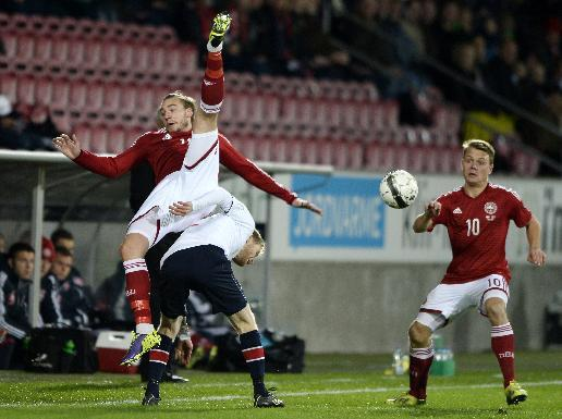 Norway's Tom Hogli, below left, and Denmark's Nicklas Bendtner, top, vie for the ball during their international friendly match in Herning, Denmark, Friday, Nov. 15. 2013