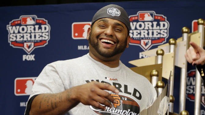 San Francisco Giants' Pablo Sandoval holds up his MVP trophy after Game 4 of baseball's World Series against the Detroit Tigers Sunday, Oct. 28, 2012, in Detroit. The Giants won 4-3 to win the series. (AP Photo/Matt Slocum, Pool )