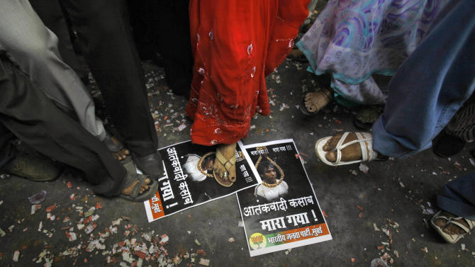 Activists of India's main opposition Bharatiya Janata Party (BJP) stamp on portraits of Mohammed Ajmal Kasab to celebrate the news of his execution, in Mumbai, India, Wednesday, Nov. 21, 2012. India executed Kasab, the lone surviving gunman from the 2008 Mumbai terror attack early Wednesday, four years after Pakistani gunmen blazed through India's financial capital, killing 166 people and throwing relations between the nuclear-armed neighbors into a tailspin. (AP Photo/Rafiq Maqbool)