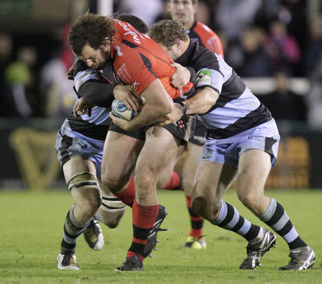 Newcastle Falcons' Mark Wilson (L) and Euan Murray (R) tackles Toulon's Carl Hayman (2R) during a pool 2, European Challenge Cup rugby union match at Kingston Park, Newcastle upon Tyne on December 8,